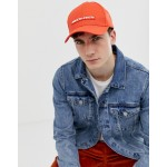 ASOS DESIGN baseball cap in red with rubber badge detail