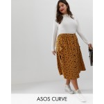 ASOS DESIGN Curve button front midi skirt in polka dot with oversized pockets