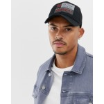 ASOS DESIGN trucker in black with badge detail
