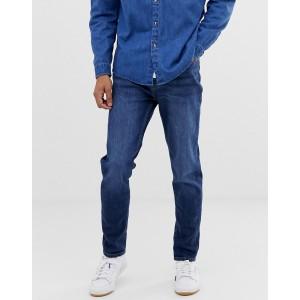 Burton Menswear carrot fit jeans in mid wash