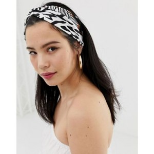 Glamorous spliced zebra print twist front headband
