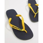 Havaianas Brasil Logo flip flops in navy and yellow