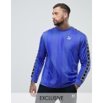 Puma long sleeve tape soccer top in purple Exclusive at ASOS