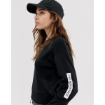 The North Face Light cropped sweat in black