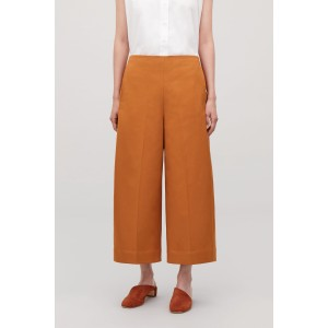 VOLUMINOUS TROUSERS WITH ZIP DETAIL