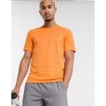 Nike Running Miler short sleeve top in orange