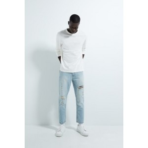 SLIM JEANS WITH RIPS