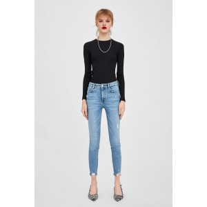 VINTAGE HI-RISE JEGGINGS WITH RIPPED DETAILS